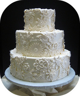Elegant Ivory Wedding Cake with Fondant Lace A...