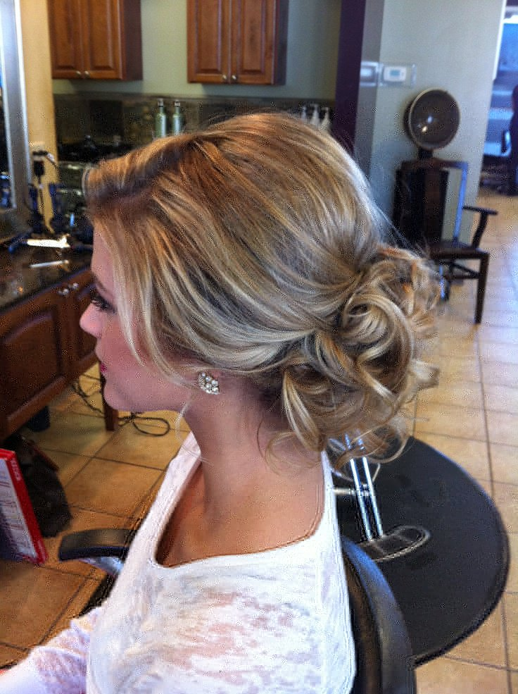 This style is similar to the one above, but the look is messier in the front and in the curled bun. Hair texture needed: Medium to Thick Hair length needed: Medium-short to Long Recommendations: Have your stylist cut face framing or long bangs to be able to have those loose tendrils down in the front.
